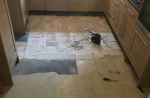 Kitchen-floor-tiling-during