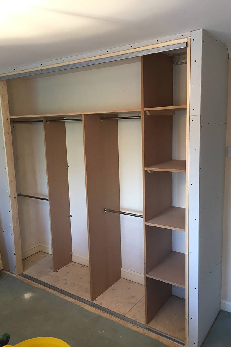 Main-bedroom-built-in-wardrobe-in-progress-shelves-800x1200